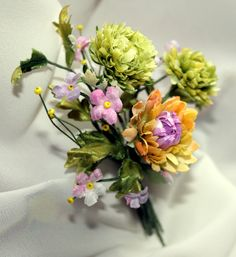 Corsages-elegant accessory for everyday or a special occasion-a bouquet of petite green Chrysanthemums adorned with lilac and pink flowers by FlowerBlues on Etsy