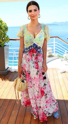 EMILY RATAJKOWSKI: The model gives off vacation vibes in her floral patchwork maxi, powder blue slide sandals and straw handbag.