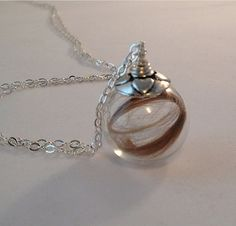 Baby's first hair cut necklace. A perfect keepsake for those precious locks. :)  by passatempojewelry.etsy.com