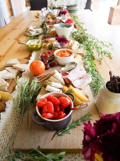 I had a lot of fun with creating the adult savoury food table. I wanted something rustic and natural, in line with the theme so I made what some people call a Crostini bar although I just think of it as a colorful, healthy lunch table. Kind of bohemian in nature. I made potato wedges and some dips – roasted red pepper and macadamia nut, spring onion and creme fraiche and hummus. I added cheeses and fruit to the table as well as grilled pita breads, bruschettas (crostinis), gherkins…