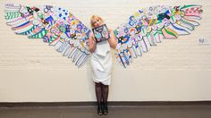 International street artist Kelsey Montague with her colouring book <i>What Lifts You<