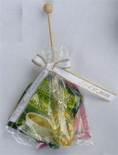 Amazing Favor of 2 fancy tea bags, combined with a unique honey-lemon spoon with wooden handle, packaged in a cellophane bag and personalized with an imprinted ribbon. Bridal Shower Tea, Tea Party Bridal Shower, Bridal Shower Favors, Baby Shower Parties, Wedding Favors, Tea Bag Favors, Tea Party Favors, Honey Spoons, Unique Gifts For Mom