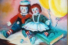 "Still life set up by Lillian Rock ""Raggedy Ann & Andy, balloons, book, marble o/c 14x18 by Katherine Cook"