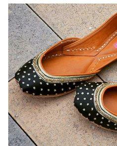0a6b03c9ae3 Deep black juttis with delicate hand embroidered zardozi work made with  genuine leather. Each pair