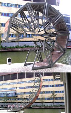 Rolling Bridge, London, by designer Thomas Heatherwick, designed by SKM Anthony Hunt with Packman Lucas, and built by Littlehampton Welding Ltd. The Hydraulic design and development was done by Primary Fluid Power Ltd in the North West.