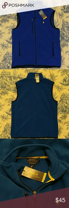 """NWT Ralph Lauren Polo Performance fleece vest Men's blue New with Tags Ralph Lauren Polo Performance fleece vest w three zippered pockets each w pull tabs. Yellow Polo ensignia. 100% polyester. Black zipper. Small retro reflective tab on back for safety. It is a royal blue. Great for Chicago Cubs fans. Size Medium. Mock turtleneck collar for warmth. 29"""" long. 22"""" across laying flat pit to pit. Unused in excellent condition. It just isn't his style. Ralph Lauren Jackets & Coats Vests"""