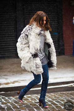 Christine Centenera in a white and grey fur coat + grey tee + skinny jeans + ankle boots