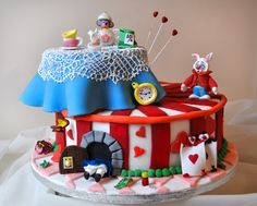 Alice in wonderland - cartoon version - Cake is a vanilla sponge cake, covered with fondant.  Models are made with Gum paste