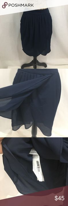 NWOT MNG by Mango navy blue tulip skirt New without tags. Never worn. USA as 8. Materials in photographs. Navy blue. Tulip style skirt. Back zipper. Measurements approx in inches. W-15 h-22 length-20   🌹no trades 🌹discounts on bundles of 2+  🌹1000 items listed, take a peak!  🌹suggested user, posh compliant: Mango Skirts