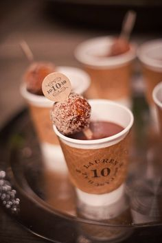"Coffee and Donuts at the reception! Perfect for a chilly evening. Personalized brown cardboard straw accent and cup sleeve contribute the the color scheme and give the drinks an authentic ""coffee house"" feel."
