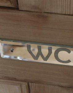 A sparkling WC mirrored door sign to show guests to the smallest room in the house!