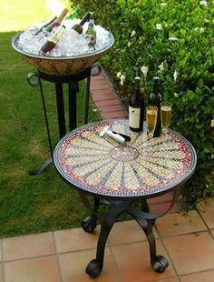 glass mosaic table browns and reds and mosaic ice bucket in the background
