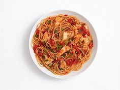 Spicy Pasta with Tilapia : Garlic, herbs and red pepper flakes give the tomato sauce full flavor, while tilapia provides lean protein and multigrain spaghetti adds fiber. Best of all, the pasta dish is on the table in 35 minutes.