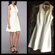 """Vince Camuto scuba white fit flare zipper dress Brand new with $128 tags. Size 2. Price drop because of the dirt smudge on the bottom (From the store- would wash out immediately.) This is a GORGEOUS BNWT dress, protective plastic still on the silver zipper. Dress this up with any kind of jewelry- it's a beautiful """"little white dress"""" for your closet! Vince Camuto Dresses"""
