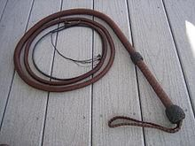 Woven parachute cord bullwhip.  I have seen a lot of things made out of paracord, but this is a first.