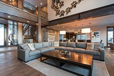 Rustic Living Room with Anton L-Sectional, High ceiling, Carpet, Hardwood floors, Balcony