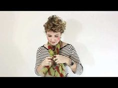 Video showing how to tie a fancy braided scarf.