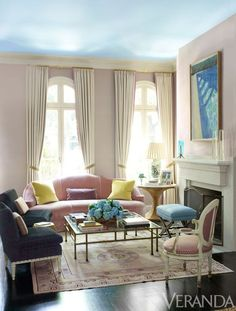 Small sofa + chairs around fireplace Chicago townhouse designed by Ruthie Sommers.