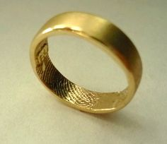Unique Wedding Rings from Brent and Jessica Williams Decorated with Fingerprints: Golden wedding ring from Brent and Jessica Williams with fingerprints inside