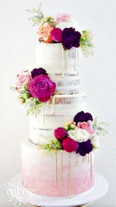 semi naked drip wedding cakes pink ombre and gold with flowers and macaroons three tier cake
