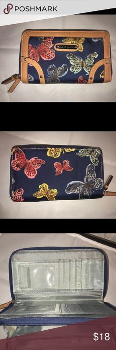 Franco Sarto Butterfly Large Phone Case Wallet This is a gorgeous like new Franco Sarto brand zip up wallet large enough to hold an iPhone  plus. Has double zipper pockets that unfold with easy to reach compartments, zipper change purse, lots of pockets for your cards and other goodies. Waterproof material in a butterfly pattern. From a smoke and pet free home Franco Sarto Bags Wallets