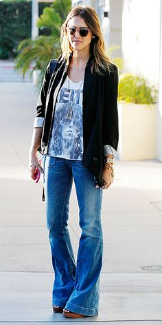 5 Ways to Wear Flares   WITH A BLAZER AND ROCKER TEE   If you want to look effortlessly cool, take notes on Jessica Alba's look. She balances the slouchiness of her tee and loose-fit of her jeans with a structured black blazer.