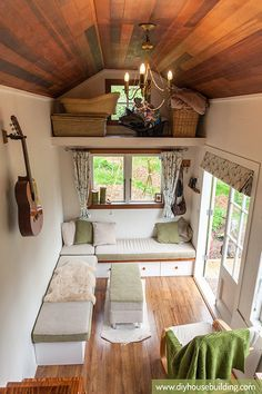 """High ceilings (9' 8"""") make this tiny trailer house seem so much larger than it is. see the rest of it here."""