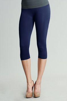 Navy Capri Leggings – Regular & Plus - These seamless capri leggings fit perfectly and comfortably on any body type.  Great for lounging, running around or a light workout.  92% Nylon/8% Spandex.  One size fits most.  Made in the USA.