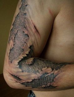 Skin made of paper. It's not so unusual for 3D tattoos to create an effect where the skin is ripped open to reveal what's underneath. This person has a tattoo on his body that shows a strange secret document hidden under his skin.