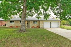 2305 Rogge Lane Austin, TX 78723 | Located in the desirable pocket just North of 51st street and East of Cameron Rd. This 3 bed, 2 bath, one story has already had all the upgrades done! Recent wood floors, windows, roof, AC, updated kitchen, granite countertops, tankless water heater, canned lighting…and the list goes on! Wonderful quarter acre lot, great trees, and a spacious backyard. Must see! Move in ready. MLS #2070492