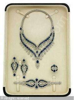 A PARURE, (5) sold by Christie's, Dubai, on Wednesday, October 27, 2010 Set of 5: sapphire and diamond, sapphires stated to weigh a total of 135.23 carats, diamonds stated to weigh a total of 82.25 carats,