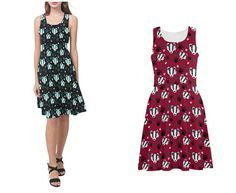 Cute badger faces and paw prints -------------------------- Options: Please choose between red and blue --------------------------- Style: Sleeveless dress made from a silky touch stretch material. Designed as a skater or fit and flare its cut to fit the bust and waist with a mid seam and then flare from the hips. The length is designed to sit on the knee but please check the measurements. This dress is versatile enough to wear under a cardigan for a smarter look, or dressed up with heels…