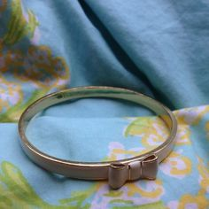 Kate Spade Take a Bow bangle Cream colored bracelet with delicate white bow and gold tone trim. Perfect condition; rarely worn. kate spade Jewelry