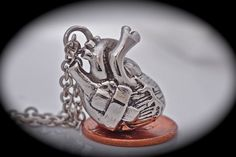 @Whitney Clark Clark Pearse  Silver anatomical heart with a band aid necklace healing a broken heart Made in NYC  original Free Shipping quantity listing. $50.00, via Etsy.