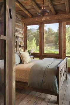 Mountaintop retreat. #bedroom #cabins #mountain I really like the 'feel' of this room, like a part of the great outdoors, simple and cozy and just look at those floorboards...I want them throughout the house!