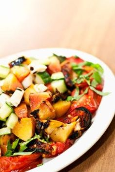 Grilled tomato and peach salad