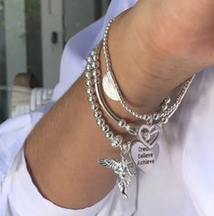 3 individual strand bracelets complete with ANNIE HAAK'S signature 925 Sterling silver 'My Guardian Angel' Charm. Silver Charm Bracelet, Silver Charms, Strand Bracelet, Bangle Bracelets, Bangles, Bracelet Designs, Raphael Angel, Archangel Raphael, Heart Charm