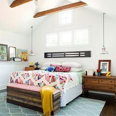 beautiful bright cottage bedroom - love the quilt, piece at the foot of the bed, and the long horizontal piece above bed instead of headboard.