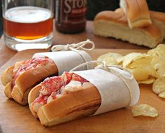 Lobster Rolls ~    Fresh lobster meat, cut into chunks  Quality Mayonnaise  Split top New England style rolls  Butter, softened  Fresh lemon juice, optional    Directions:  Mix together lobster meat and mayonnaise (to your liking - I don't add much)    Add a squeeze of lemon juice (optional)    Butter the outside and inside
