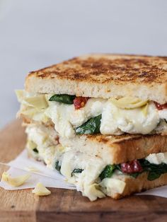 This gooey grilled cheese sandwich uses three kinds of cheese plus artichokes and spinach, my favorite pizza flavors in a sandwich
