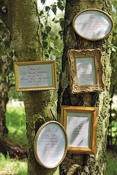 These little gold frames with personal saying mounted to a nearby tree add rustic charm.