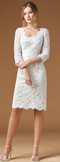 Sheath in Alencon lace with scoop neckline and ¾ sleeves.