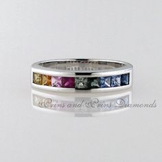 9 = multi coloured square cut sapphires set in white gold Sapphire, Gemstone Rings, White Gold, Wedding Rings, Rainbow, Engagement Rings, Color, Jewelry, Rain Bow