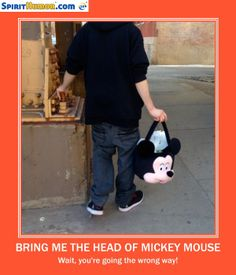 Or maybe this IS Mickey Mouse... carrying his head... because of a low bridge ahead.