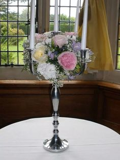 Candelabra with fresh roses and gyp