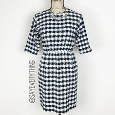 """Vintage Style Houndstooth Sheath Dress Classic black and white houndstooth print. Sheath dress with three quarter length sleeves, cinched waist, and wide neckline. 100% rayon. Dry clean only. Size S. Bust is 17"""" and length is 35."""" Brand is Bedford Fair. Vintage style look. Excellent condition. Thanks for looking! Bedford Fair Dresses"""