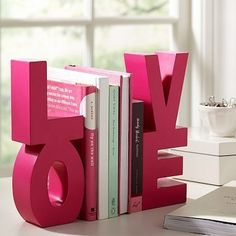 Paint and glue together block letters and use for book ends. Cute for a kids room or play room