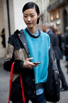 Paris Street Style Couture 2013. A Maje fur coat and beachy-turquoise make for an unexpected duo.