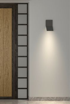 The epitome of minimalist, modern design, the Leev outdoor wall sconce by Tech Lighting is composed of a single die-cast metal plane creased perfectly to aim LED up for architectural accent lighting, or down for ambient and way-finding illumination. Ideal for indoor or outdoor applications where a clean, yet dramatic aesthetic complements the space. This uniquely contemporary outdoor light fixture features a durable, marine grade powder coat finish available in two finishes: Charcoal or…