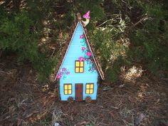 Fancy Fairy House. Left over Masonite, 2x2' s, staple gun, polymer clay, paint, pine cones, acorns, branches, sweet gum balls, and glue gun. Voila! By Rambrosius Gifts
